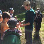 Teen assistant teaching kids