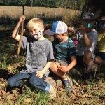 Kids sitting on a log