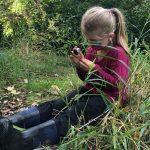 Girl looking through magnifier